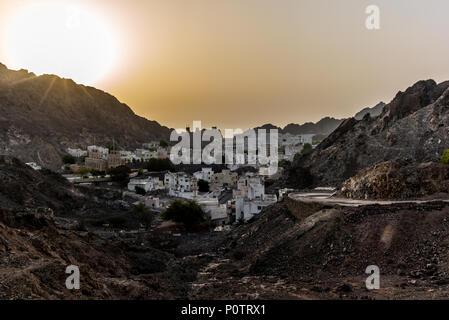 Sunrise in summer on the old town of Muscat in Oman - 1 - Stock Photo