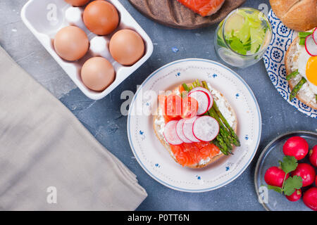 Bread with cheese, salmon and asparagus. Different Healthy Eating. Delicious breakfast for the family. View from above. - Stock Photo