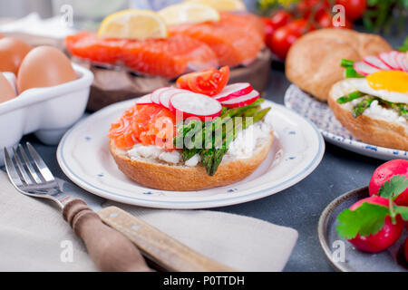Bread with cheese, salmon and asparagus. Different Healthy Eating. Delicious breakfast for the family - Stock Photo