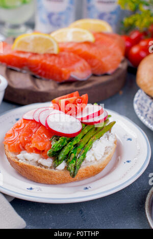 Bread with cheese, egg and asparagus, another bread with salmon and. asparagus. Different Healthy Eating. Delicious breakfast for the family - Stock Photo