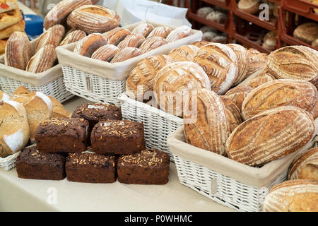 Sourdough and pumpernickel bread for sale at Daylesford Organic farm summer festival. Daylesford, Cotswolds, Gloucestershire, England - Stock Photo