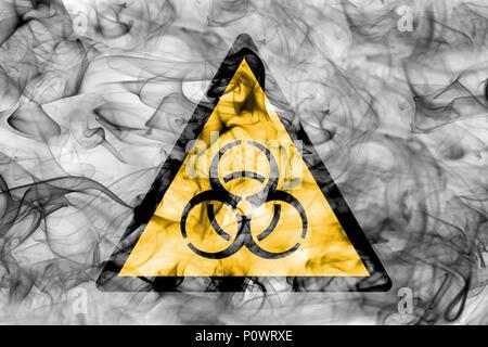 Biohazard hazard warning smoke sign. Triangular warning hazard sign, smoke background. - Stock Photo