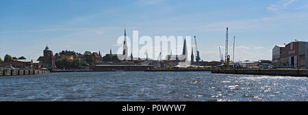 Panorama image of Hanseatic city of Luebeck with trave river, Luebeck, Germany - Stock Photo