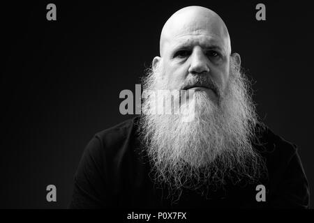 Black And White Portrait Of Mature Bald Man With Long Beard - Stock Photo
