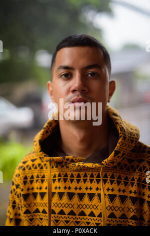 Young multi-ethnic Asian man in the streets outdoors - Stock Photo