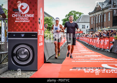 Herning, Denmark, 9th June 2018 UK Sport: Camilla Pedersen is escorted from the course during the middle distance triathlon in Herning  Credit Northern Sport/Alamy Live News - Stock Photo