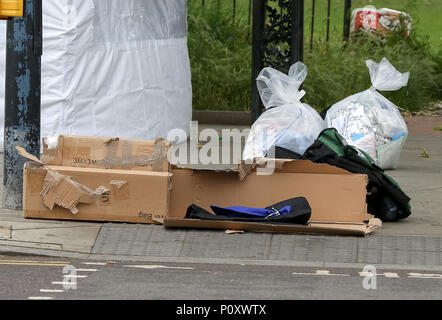 Turnpike Lane, North London. UK 10 June 2018 - Police tent at the crime scene in Ducketts Common outside Turnpike Lane station in North London. A man was stabbed to death at about 9.45pm on Saturday 9 June 2018 outside a busy tube station where they found a 'seriously injured' man. Credit: Dinendra Haria/Alamy Live News - Stock Photo