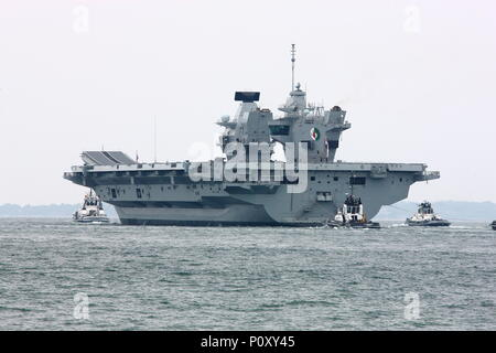 Portsmouth, UK. 10th June 2018. Watched by a huge crowd, Royal Navy aircraft carrier HMS Queen Elizabeth departs her home port of Portsmouth for her latest deployment. - Stock Photo
