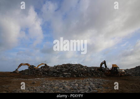 (180610) -- COLOMBO, June 10, 2018 (Xinhua) -- Stones are sorted at the construction site of the Colombo Port City, Colombo, Sri Lanka, June 8, 2018. Spread over 269 hectares of land reclaimed from the sea adjacent to the present commercial district of Colombo, the Colombo Port City, co-developed by the Sri Lankan government and China's CHEC Port City Colombo (Pvt) Ltd under the Belt and Road Initiative, will in future become a commercial, financial, residential and international entertainment hub in the Indian Ocean region. TO GO WITH Feature: Story of stone in Colombo Port City (Xinhua/Zhu R - Stock Photo