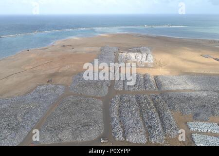 Colombo. 10th June, 2018. Stones are seen at the construction site of the Colombo Port City, Colombo, Sri Lanka, June 8, 2018. Spread over 269 hectares of land reclaimed from the sea adjacent to the present commercial district of Colombo, the Colombo Port City, co-developed by the Sri Lankan government and China's CHEC Port City Colombo (Pvt) Ltd under the Belt and Road Initiative, will in future become a commercial, financial, residential and international entertainment hub in the Indian Ocean region. TO GO WITH Feature: Story of stone in Colombo Port City Credit: Xinhua/Alamy Live News - Stock Photo