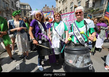 London, UK. 10th June 2018. Women take part in the London 'Processions' artwork march, to mark 100 years  since the Representation of the People Act gave the first British women the right to  vote and stand for public office. Women and girls in Belfast, Cardiff, Edinburgh and  London are walking together today, wearing either green, white or violet, the colours  of the suffrage movement. Credit: Vickie Flores/Alamy Live News - Stock Photo