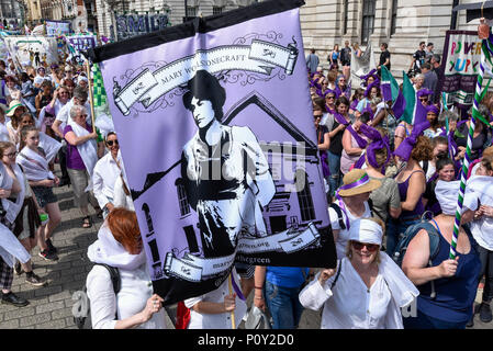 London, UK.  10 June 2018.  Over 40,000 women and girls take part in 'Processions', a mass participation artwork to celebrate one hundred years of votes for women.  Walking together from Park Lane to Westminster participants wear either green, white or purple scarves representing the colours of the Suffragette movement.  Similar walks took place in Belfast, Cardiff and Edinburgh.  Credit: Stephen Chung / Alamy Live News - Stock Photo