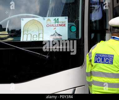 London, UK. 10th June 2018. Al Quds day protest organised by IHRC in London goes ahead despite demands that Hezbollah flags should not be flown. Counter protests from Israeli supporters and Free Tommy Robinson supporters led to a large police presence. Coaches brought Muslims from Luton for Al- quds Credit: Londonphotos/Alamy Live News - Stock Photo