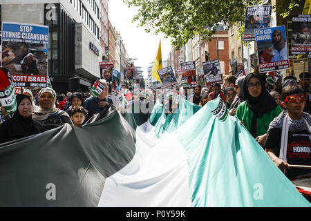 London, UK. 10th June, 2018. Demonstrators take part in the annual pro-Palestine/anti-Israel Al Quds Day demonstration in central London. The demonstration is notably controversial in the city for the flying of Hizbullah flags that typically takes place during the course of it. Credit: David Cliff/SOPA Images/ZUMA Wire/Alamy Live News - Stock Photo
