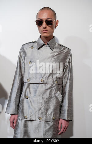 London, UK. 10th June 2018. A model backstage ahead of the Alex Mullins show during London Fashion Week Men's June 2018 at the BFC Show Space on June 10, 2018 in London, England. Credit: Krisztian Pinter/Alamy Live News - Stock Photo