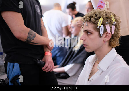 London, UK. 10th June 2018. A model backstage ahead of the MAN show during London Fashion Week Men's June 2018 at the BFC Show Space on June 10, 2018 in London, England. Credit: Krisztian Pinter/Alamy Live News - Stock Photo