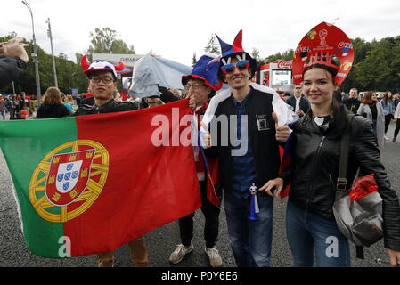 Moscow, Russia. 10th June, 2018. MOSCOW, RUSSIA - JUNE 10, 2018: Fans hold the Portuguese national flag as they attend the opening of the FIFA Fan Fest on Vorobyovy Gory (Sparrow Hills) ahead of the 2018 FIFA World Cup. Mikhail Japaridze/TASS Credit: ITAR-TASS News Agency/Alamy Live News - Stock Photo