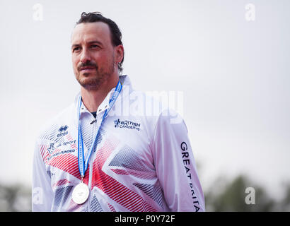 Belgrade, Serbia. 10th Jun, 2018. Nicholas Beighton of GBR celebrates on the podium at the medal ceremony for the Men's KL2, 200m sprint race Credit: Nikola Krstic/Alamy Live News - Stock Photo