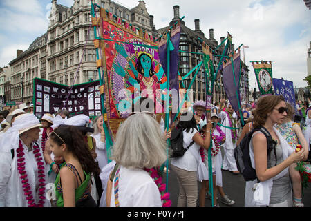 London, UK - 10 June 2018:  Women march through London in the colours of the suffragette movement to celebrate the centenary of women getting the vote. Credit: On Sight Photographic/Alamy Live News - Stock Photo