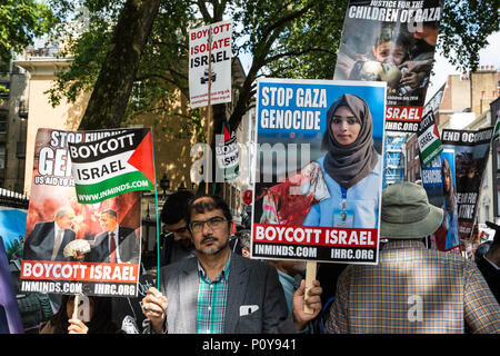 London, UK. 10th June, 2018. Hundreds of people wait outside the Saudi embassy to take part in the pro-Palestinian Al Quds Day march through central London organised by the Islamic Human Rights Commission. An international event, it began in Iran in 1979. Quds is the Arabic name for Jerusalem. Credit: Mark Kerrison/Alamy Live News - Stock Photo