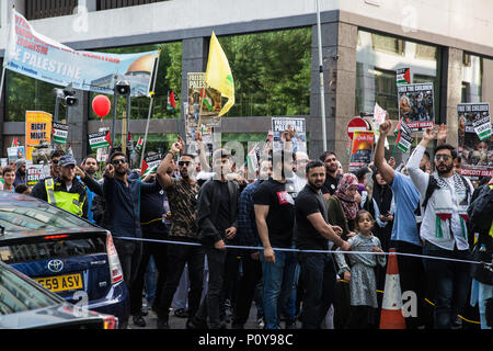 London, UK. 10th June, 2018. Hundreds of people take part in the pro-Palestinian Al Quds Day march through central London organised by the Islamic Human Rights Commission. An international event, it began in Iran in 1979. Quds is the Arabic name for Jerusalem. Credit: Mark Kerrison/Alamy Live News - Stock Photo