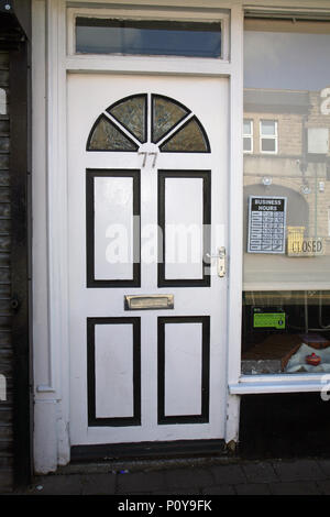 number 77 door in Dinnington South Yorkshire an old mining town - Stock Photo