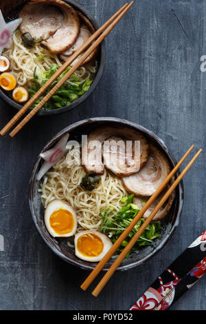 Japanese ramen soup with pork, egg and chives - Stock Photo
