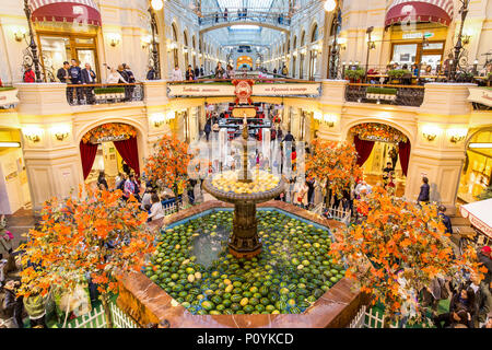 Moscow, Russia - September 16, 2017: Gum department store, the oldest shopping mall decorated by watermelons in fountain roundabout. - Stock Photo