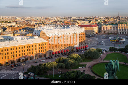 Saint Petersburge, Russia - September 17, 2017: Aerial view St. Isaac's Cathedral over old buildings and roads around St. Isaac's square before sunset - Stock Photo