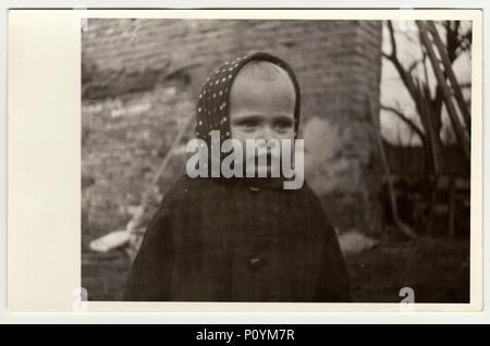 THE CZECHOSLOVAK REPUBLIC, CIRCA 1942: Vintage photo shows a small girl wears bandanna, circa 1942. - Stock Photo