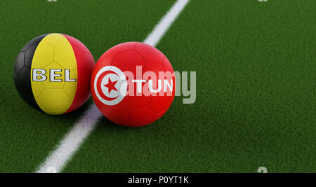 Belgium vs. Tunisia Soccer Match - Soccer balls in Belgiums and Tunisias national colors on a soccer field. Copy space on the right side - Stock Photo