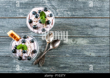 cottage cheese dessert with blueberries and slices of Viennese waffles in a glass cup. Top view. Copy space - Stock Photo