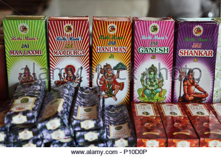 Boxes of incense with the images of Hindu deities at an Indian shop specializing in religious items. - Stock Photo