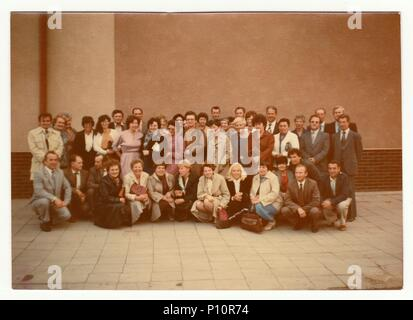 THE CZECHOSLOVAK SOCIALIST REPUBLIC - OCTOBER, 1985: Vintage photo shows group of people (former classmates) and their meeting after years. - Stock Photo