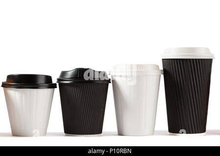 Four disposable coffee cups ascending height in a row alternating black and white on white background with copy space - Stock Photo