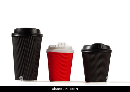 Three plastic coffee cups on white background with copy space - Stock Photo
