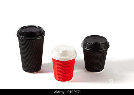 Black and red disposable coffee cups on white background with copy space - Stock Photo