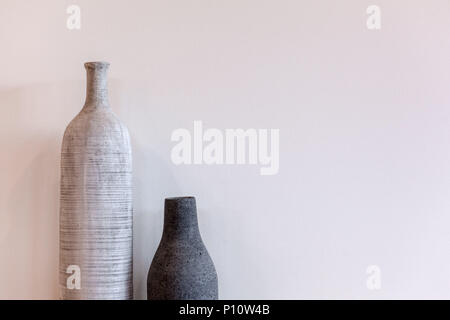 Two Decorative Modern Vases Long And Short On Wooden Floor Against