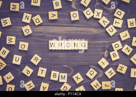 Wrong word wood block on table for business concept. - Stock Photo