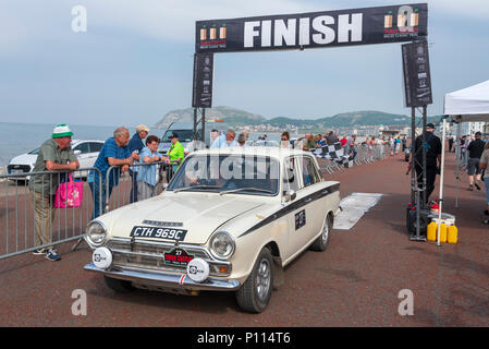 The finish at Llandudno of the 2018 3 Castles Trial motor event for vintage cars. Lotus Cortina. - Stock Photo
