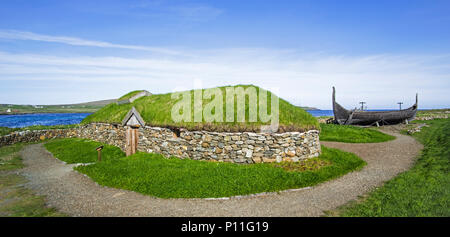 Reconstruction of Norse Viking longhouse and the Skidbladner, full size replica of Gokstad ship at Brookpoint, Unst, Shetland Islands, Scotland, UK - Stock Photo