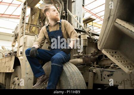 Repairman Resting On Truck - Stock Photo