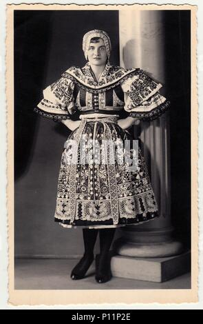 HODONIN, THE CZECHOSLOVAK REPUBLIC - CIRCA 1920s: Vintage photo shows woman in a folk costum. - Stock Photo