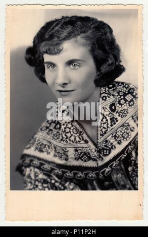 HODONIN, THE CZECHOSLOVAK REPUBLIC - CIRCA 1920s: Vintage studio photo portrait shows woman in a folk costum. - Stock Photo