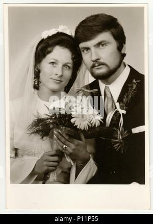 THE CZECHOSLOVAK SOCIALIST REPUBLIC - CIRCA 1970s: Vintage photo of newlyweds. - Stock Photo