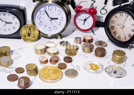 Abstract photo of crypto-cyrency and time. A lot of clocks isolated on white background. - Stock Photo