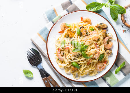 Pasta spaghetti with seafood and cream sauce on white. - Stock Photo