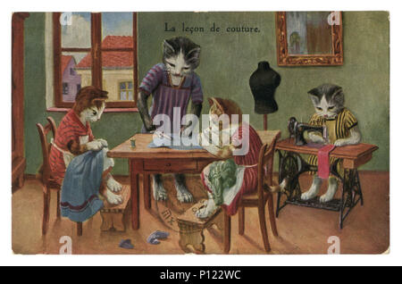 French historical postcard: Cats as people. Female cats in dresses sew clothes. The lesson of cutting and sewing, postmark 1937, Republic of france - Stock Photo