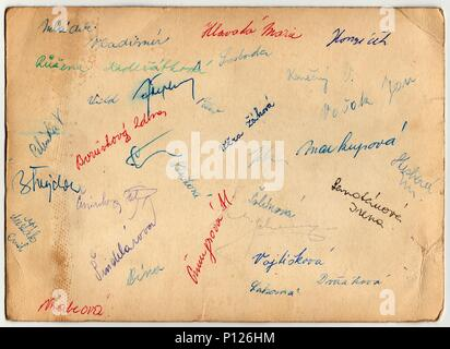 THE CZECHOSLOVAK SOCIALIST REPUBLIC - CIRCA 1960s:  The back of vintage photo shows signatures. - Stock Photo