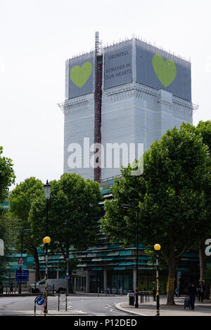 London, UK, 9yh Jun 2018 Daytime. Grenfell Tower, Scene of the disastrous fatal fire on the week of the first anniversary. The tower is noe covered - Stock Photo